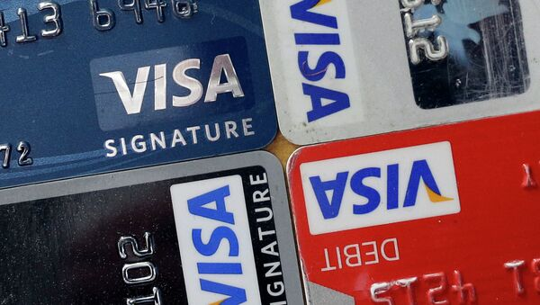 In this April 25, 2013 file photo, credit and debit cards are displayed for a photographer in Baltimore. Visa Inc. reports quarterly earnings on Thursday, April 24, 2014 - Sputnik International
