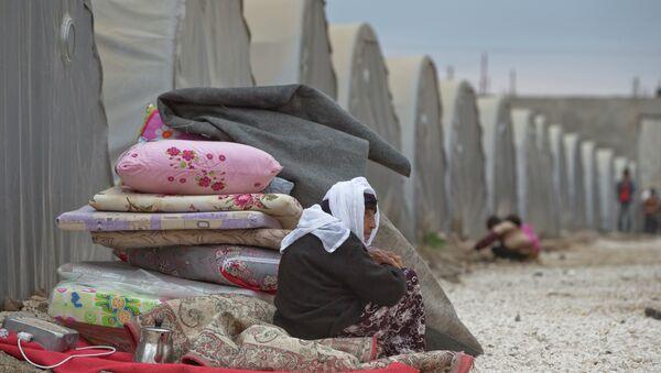 A Syrian Kurdish refugee woman - Sputnik International