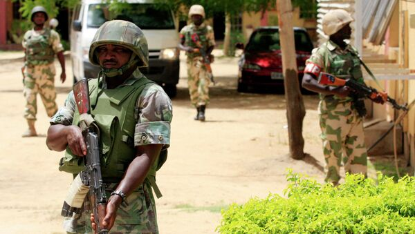 Nigerian soldiers stand guard at the offices of the state-run Nigerian Television Authority in Maiduguri, Nigeria. Archive photo. - Sputnik International