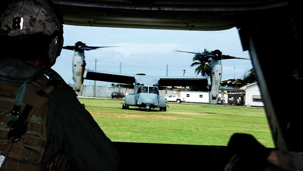 View from the rear ramp of a US Marine Corps MV-22B Osprey before it takes off from Barclay Training Center in Monrovia, Liberia - Sputnik International