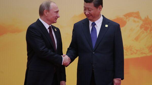 November 11, 2014. Russian President Vladimir Putin, left, and Chinese President Xi Jinping - Sputnik International