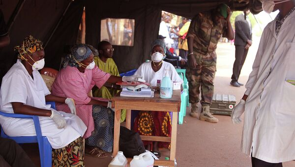 Health care workers at a screening center for the Ebola virus await patients at the border village of Kouremale, Mali - Sputnik International