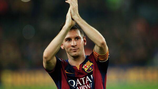 Barcelona's Lionel Messi celebrates at the end of their Spanish first division soccer match against Sevilla at Nou Camp stadium in Barcelona November 22, 2014 - Sputnik International