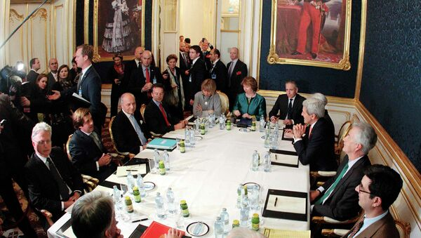 French Foreign Minister Laurent Fabius (3rd L), EU envoy Catherine Ashton (6th L), U.S. Secretary of State John Kerry (3rd R) and Britain's Foreign Secretary Philip Hammond (front L) sit a a table during talks in Vienna November 21, 2014 - Sputnik International