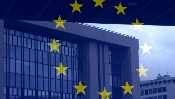 European Council building is reflected in a photograph of the EU flag on the wall of the European Council building, in Brussels - Sputnik International