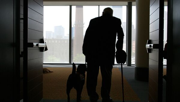 Wilson Hulley of Chevy Chase, Md., and his service dog Laurel leave at the end of the New England Assistance Dog Services (NEADS) graduation for dogs who assist the deaf and disabled at the Boston Convention and Exhibition Center - Sputnik International