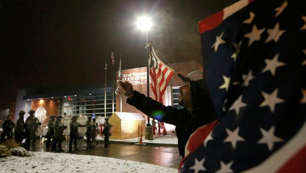 A protester shouts at the National Guard standing on duty outside the Ferguson Police Department after the grand jury verdict in the Michael Brown shooting in Ferguson, Missouri, November 26, 2014 - Sputnik International