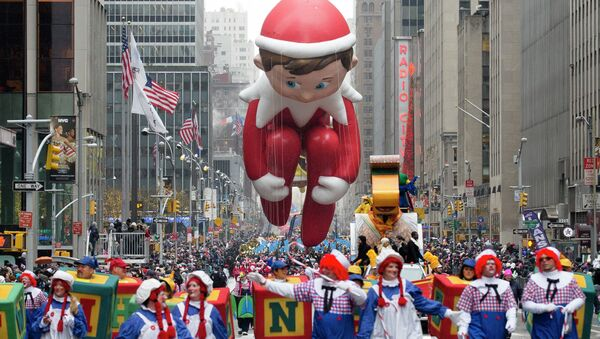 The Elf on the Shelf balloon is marched down Sixth Avenue during the Macy's Thanksgiving Day Parade, Thursday, Nov. 27, 2014, in New York - Sputnik International