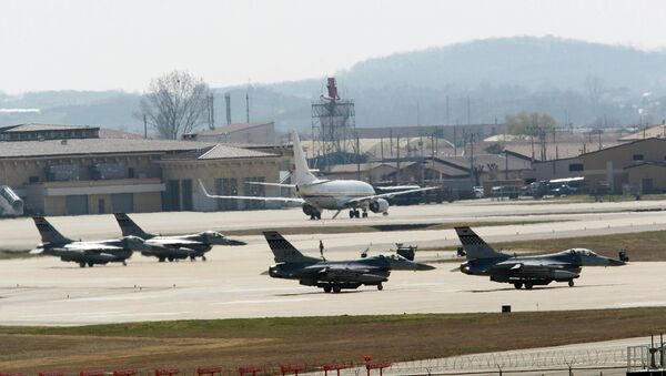 U.S. Air Force F-16 fighter jets wait to take off from a runway during a military exercise at the Osan U.S. Air Base in Osan, South Korea - Sputnik International