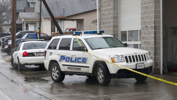 Westover Police vehicles are parked outside Doug's Towing in Westover, W.V.,, Monday, Dec. 1, 2014, after three separate shootings left four people dead on Monday - Sputnik International