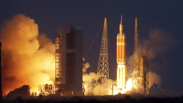 NASA's Orion spacecraft, atop a United Launch Alliance Delta 4-Heavy rocket, lifts off on its first unmanned orbital test flight from the Cape Canaveral Air Force Station Friday, Dec. 5, 2014 - Sputnik International