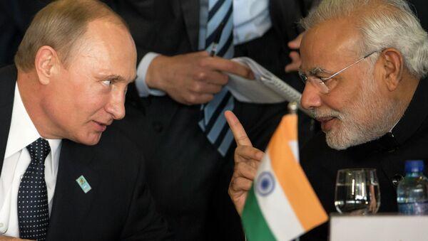 Russia's President Vladimir Putin, left, and India's Prime Minister Narendra Modi chat during the BRICS Summit at the Itamaraty Palace, in Brasilia, Brazil, Wednesday, July 16, 2014 - Sputnik International