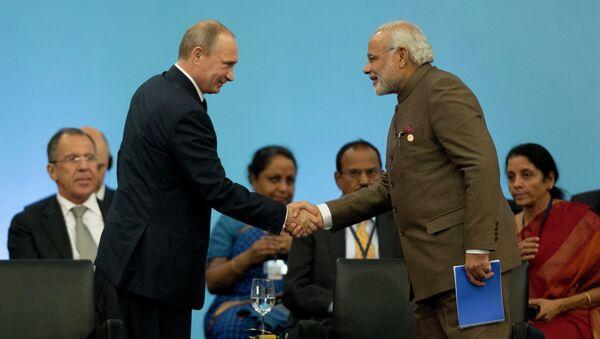 Russia's President Vladimir Putin, left, and India's Prime Minister Narendra Modi - Sputnik International