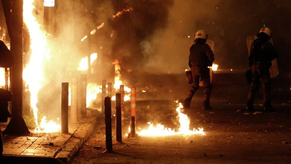Riot police try to avoid petrol bombs thrown by protesters during clashes in the Athens neighborhood of Exarchia, a haven for extreme leftists and anarchists, on Saturday, Dec. 6, 2014 - Sputnik International