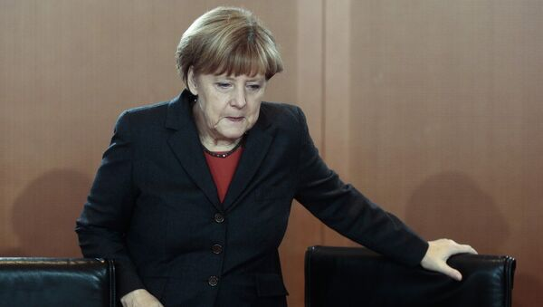 German Chancellor Angela Merkel arrives for the cabinet meeting in Berlin, Germany, Wednesday, Dec. 3, 2014 - Sputnik International