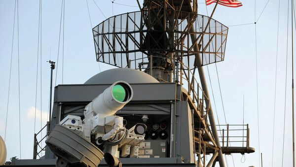 The laser weapon system (LaWS) is tested aboard the USS Ponce amphibious transport dock during an operational demonstration while deployed in the Gulf. File photo - Sputnik International