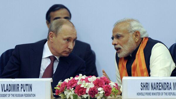 Russian President Vladimir Putin (left) and Indian Prime Minister Narendra Modi attending the World Diamond Conference in the Vigyan Bhawan Palace, New Delhi - Sputnik International
