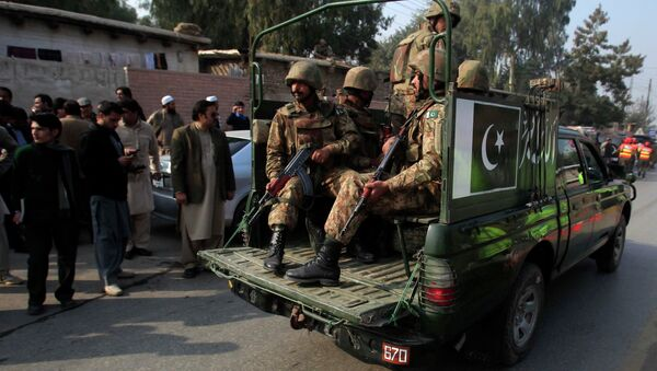 Pakistani security forces drive on a road leading to the Army Public School, which is under attack from Taliban gunmen, in Peshawar, December 16, 2014 - Sputnik International