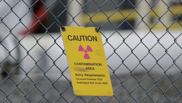 A sign warning of radioactive contamination - Sputnik International
