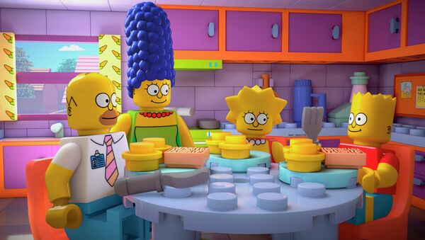 This image released by FOX shows characters from the animated series, The Simpsons, from left, Homer, Marge, Lisa and Bart, as Lego figures - Sputnik International