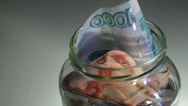 Ruble and euro banknotes of different denominations in a jar. - Sputnik International