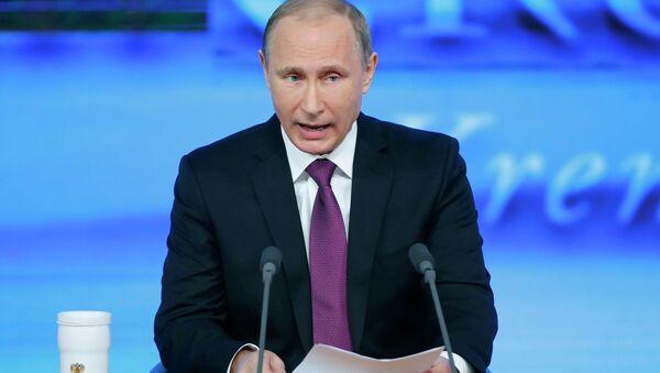 Russian President Vladimir Putin said current downturn in Russian economy was provoked by external factors. - Sputnik International