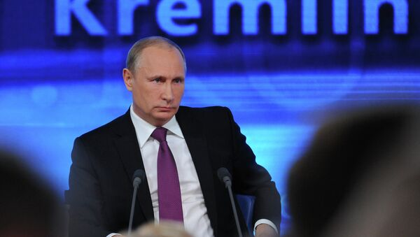 Russian President Vladimir Putin speaks during his annual news conference in Moscow - Sputnik International