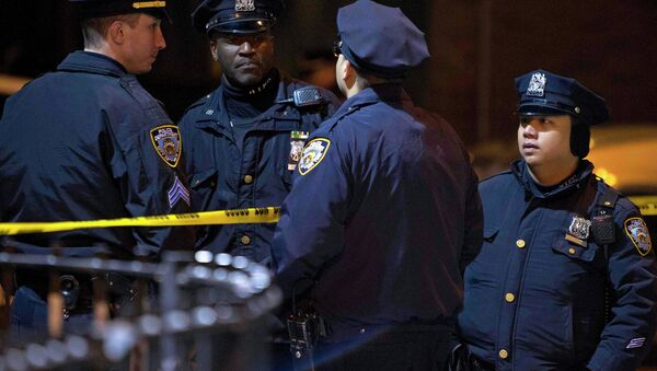Police are pictured at the scene of a shooting where two New York Police officers were shot dead in the Brooklyn borough of New York, December 20, 2014 - Sputnik International