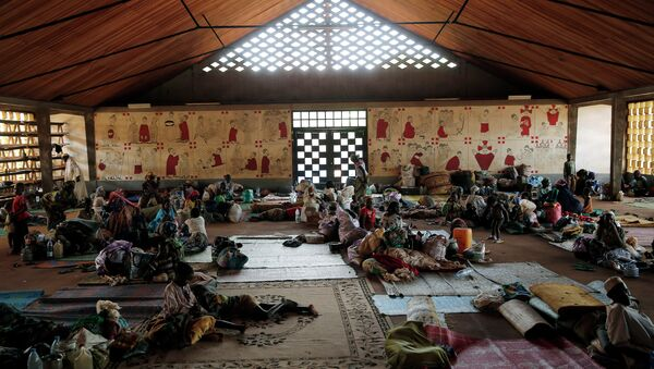 In this Monday, April 14, 2014 photo, Muslim refugees rest inside the Catholic church in Carnot, Central African Republic - Sputnik International