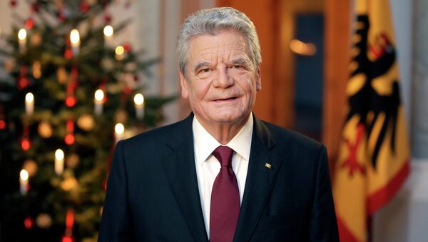 German President Joachim Gauck poses after the recording of the traditional Christmas message at Bellevue Palace in Berlin, December 22, 2014 - Sputnik International
