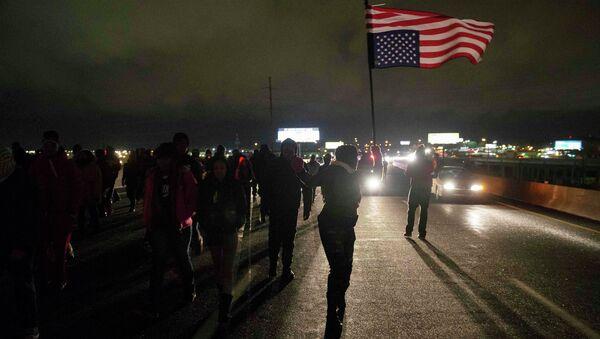 Protesters block Highway 170, after a man was fatally shot by a police man in Berkeley, Missouri, December 24, 2014. - Sputnik International