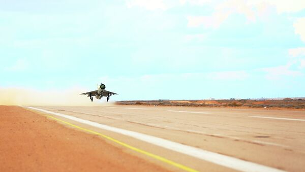 A MiG-21 fighter jet belonging to forces loyal to former general Khalifa Haftar takes off from a base on the outskirts of Al Sidra oil port, in Ras Lanuf - Sputnik International