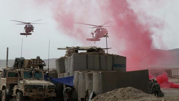 Black Hawk Helicopters coming in to land at firebase in Afghanistan - Sputnik International