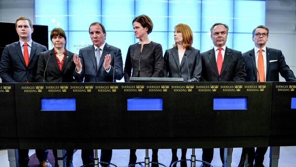 Prime Minister Stefan Lofven gestures next to  leaders of Swedish political parties during a news conference at the Swedish Parliament in Stockholm - Sputnik International