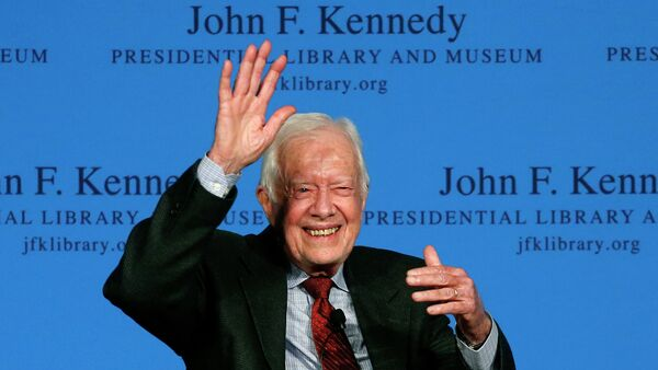 Former President Jimmy Carter waves to a member of the audience after a forum at the John F. Kennedy Presidential Library and Museum in Boston - Sputnik International