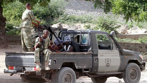 Somalia security forces transport blind-folded suspects detained on their pick-up truck after attackers from the militant group al Shabaab invaded the African Union's Halane base on the edge of the Mogadishu international airport compound in Somalia's capital Mogadishu - Sputnik International