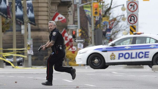Ottawa authorities have released CCTV footage showing the actions of Michael Zehaf-Bibeau, who fatally shot Corporal Nathan Cirillo guarding the National War Memorial on the Parliament Hill - Sputnik International