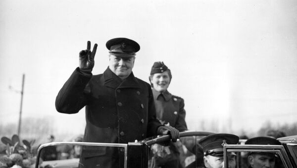 Winston Churchill holds up two fingers to make a V-sign for Victory as he salutes from an open car in Antwerp, Belgium, on Nov. 17, 1945 - Sputnik International
