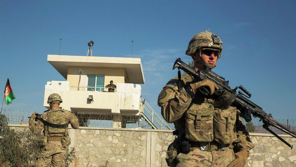 A U.S. soldier from Dragon Company of the 3rd Cavalry Regiment stands in front of an Afghan National Army guard post during a mission near forward operating base Gamberi in the Laghman province of Afghanistan December 28, 2014 - Sputnik International