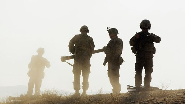 U.S. soldiers from D Troop of the 3rd Cavalry Regiment walk on a hill after finishing with a training exercise near forward operating base Gamberi in the Laghman province of Afghanistan December 30, 2014 - Sputnik International