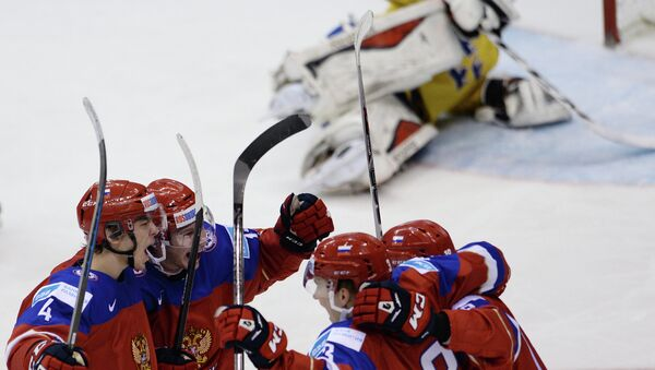 Russian players celebrate their victory in the Ice Hockey World Junior Championships semifinal between the national teams of Sweden and Russia in Toronto, Canada - Sputnik International