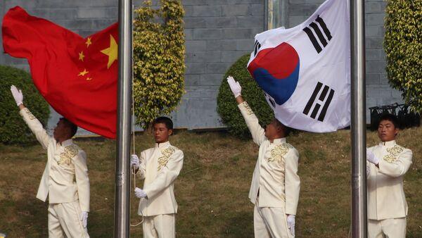 The flags of China, South Korea and North Korea - Sputnik International