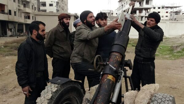 Free Syrian Army fighters use an iPad as they prepare to launch a weapon toward the forces of Syria's President Bashar al-Assad in Ain Tarma, in Eastern Ghouta, a suburb of Damascus January 3, 2015. - Sputnik International