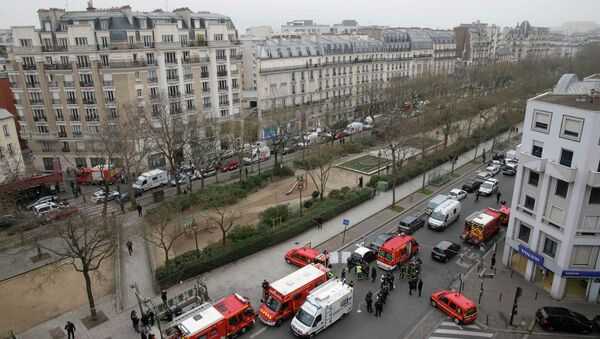 Police and rescue forces are seen near the scene after a shooting at the Paris offices of Charlie Hebdo, a satirical newspaper, January 7, 2015 - Sputnik International