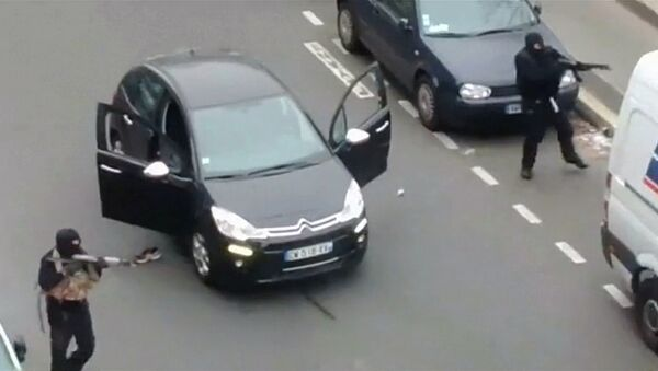 Gunmen flee the offices of French satirical newspaper Charlie Hebdo in Paris, in this still image taken from amateur video shot on January 7, 2015, and obtained by Reuters - Sputnik International