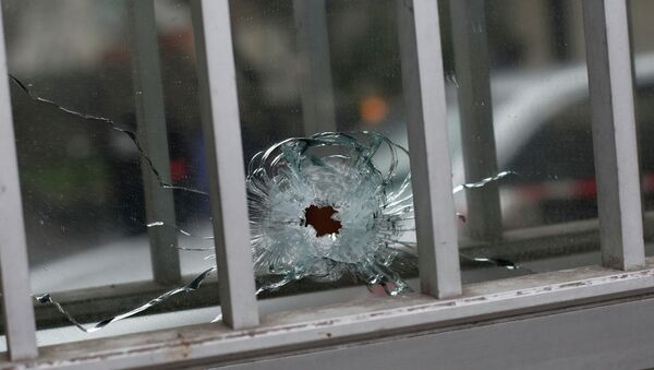 A bullet impact is seen in a window - Sputnik International