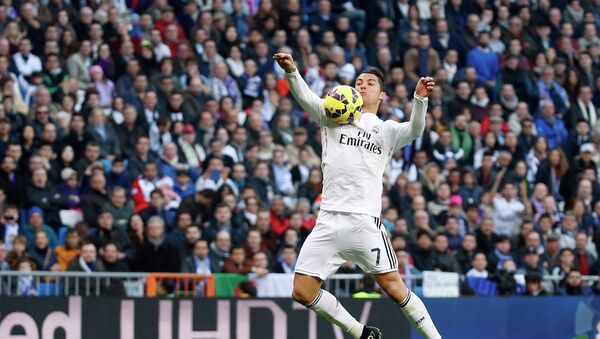 Real Madrid's Cristiano Ronaldo controls the ball during their Spanish first division soccer match against Espanyol at Santiago Bernabeu stadium in Madrid January 10, 2015. - Sputnik International