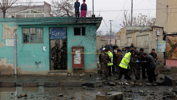 Afghan security personnel investigate the site of a blast in Kabul January 13, 2015. - Sputnik International