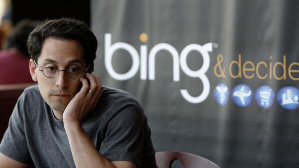 Microsoft employee Joshua Schnoll sits near a sign promoting Bing, Microsoft's recently upgraded search engine, in a company cafeteria in Redmond, Wash - Sputnik International