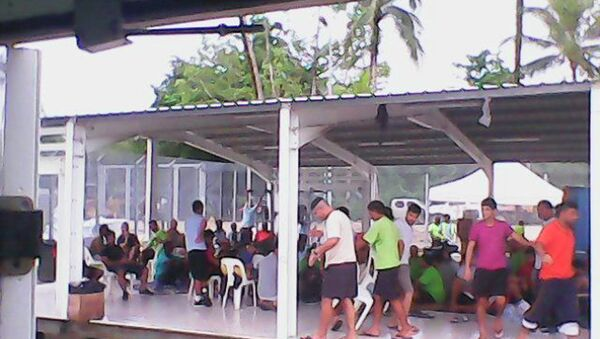 Asylum seekers are pictured in this handout photo provided by the refugee action coalition, taken inside the Manus Island detention centre in Papua New Guinea January 13, 2015 - Sputnik International